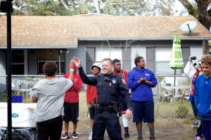 Officer Bobby White and neighborhood basketball players. Credit: Gainesville, FL police department.
